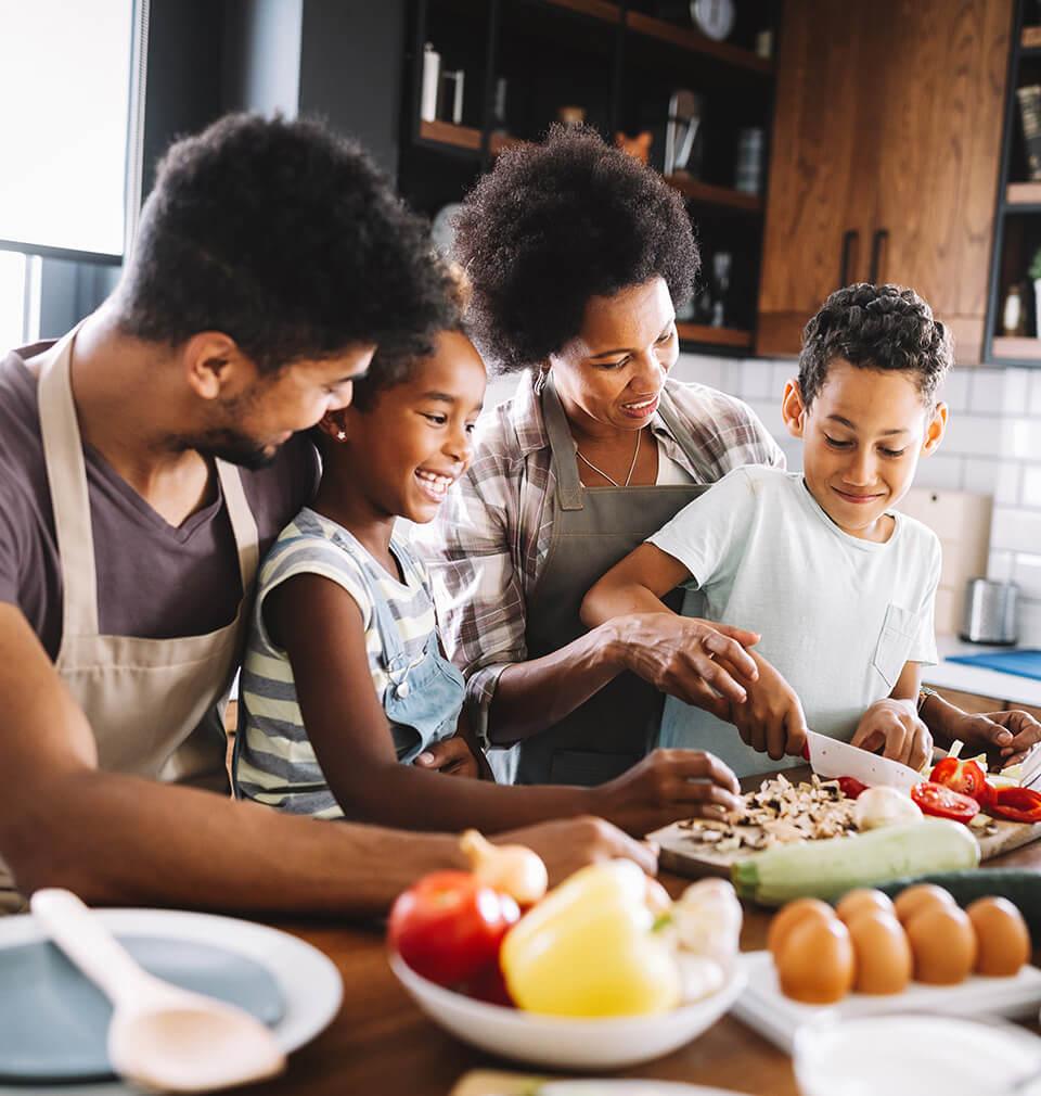 A Black family makes dinner