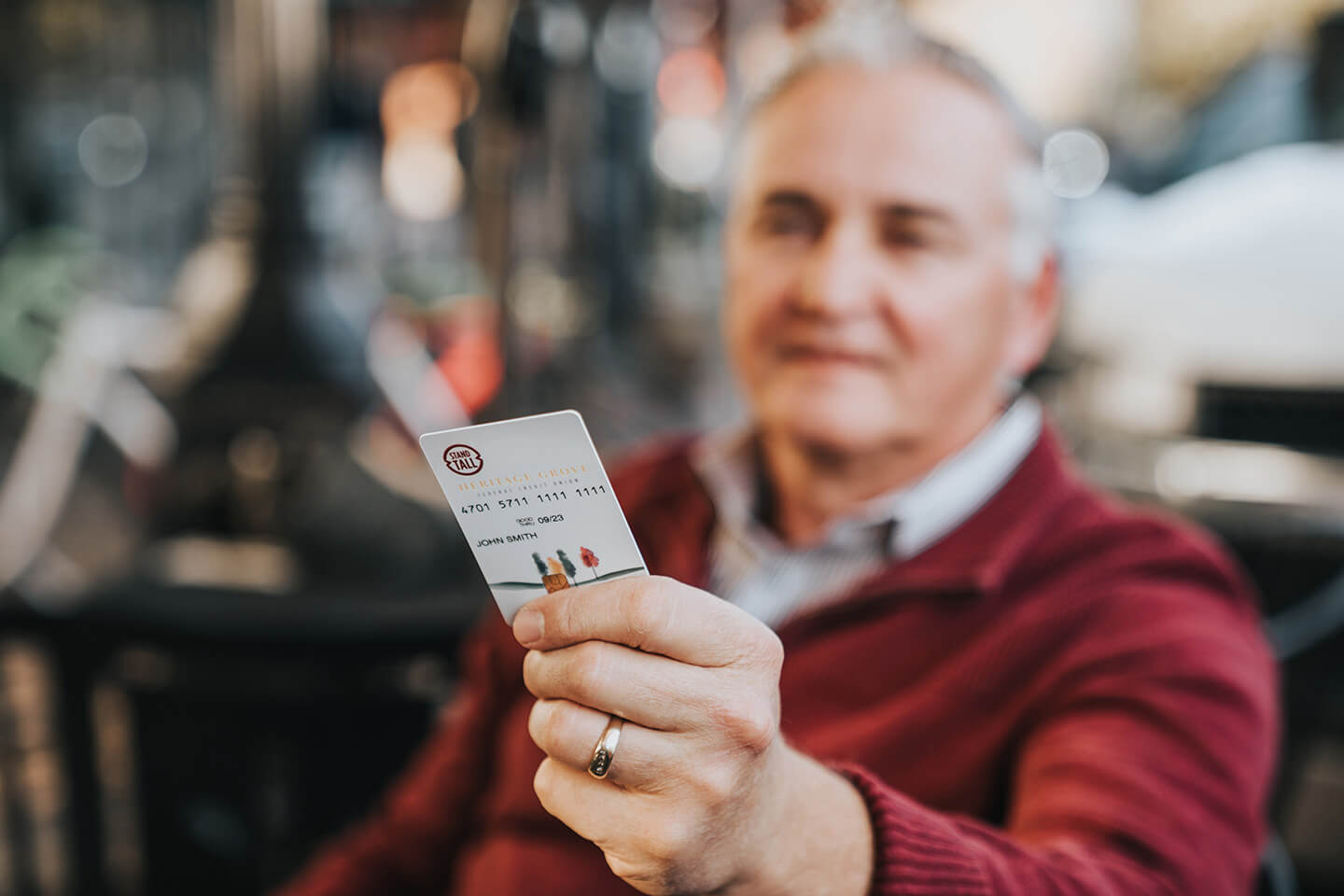 man with Heritage Grove credit card